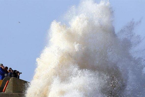 No obstante, residentes de zonas costeras se preparan para más in...