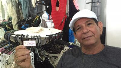 Victor Rodriguez, who runs a small clothing business in Cuba making croc...