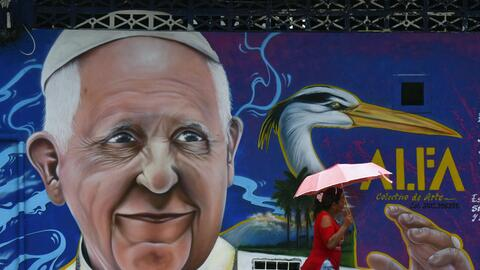 A painting of Pope Francis in Villavicencio, Colombia. Francis arrives i...