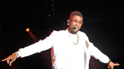 R&B Singer Usher sings and dances on stage at the Paul Brown Stadium...