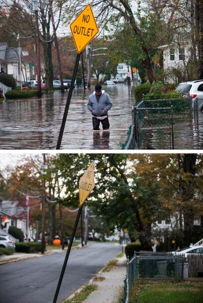 El 30 de octubre un cabizbajo hombre caminaba por una calle inundada en...