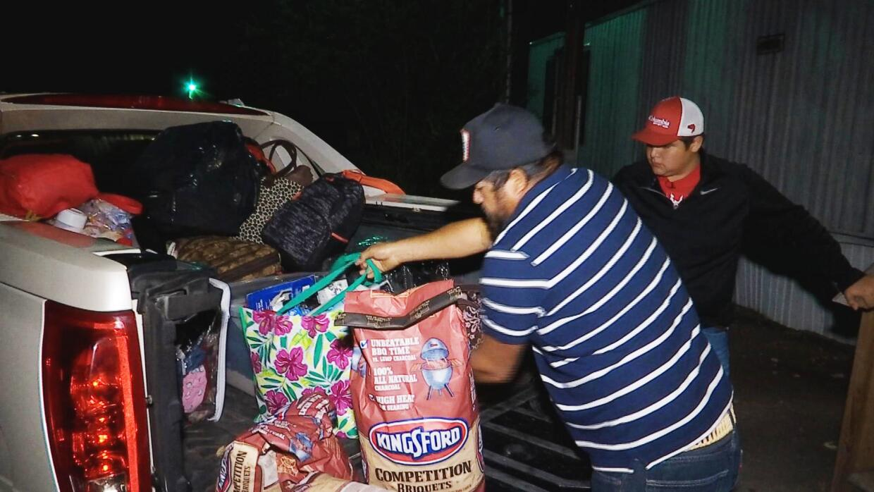 The Morenos pack their belongings to start their return to Immokalee, Fl...