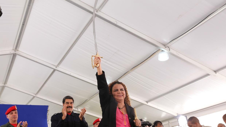 Iris Varela (C), former Venezuela's Prisons Minister, holds a replic...