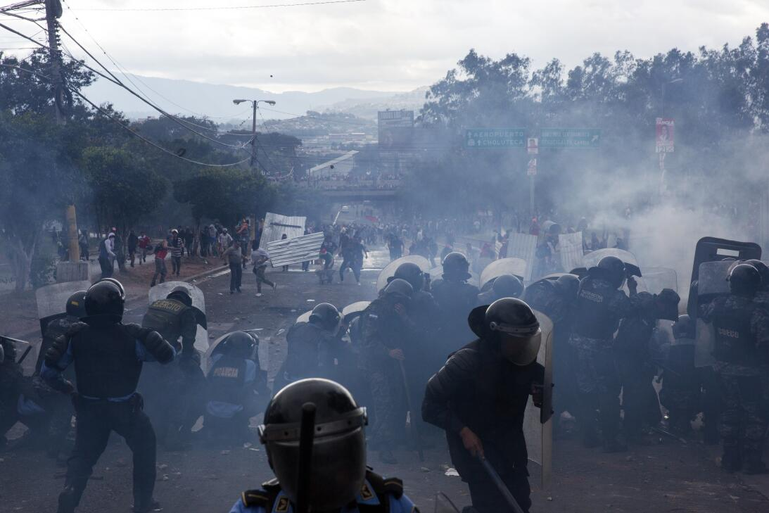 In photos: Police clash with the opposition protesters over disputed ele...