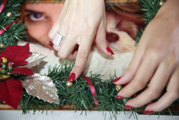 Pondré la foto en un marco y lo decoraré con guirnaldas y motivos navide...