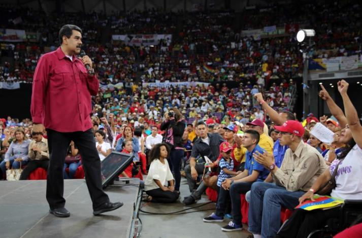 Nicolas Maduro addresses supporters at at event on June 27 as the helcop...