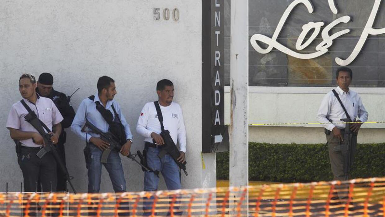 Policías resguardan la zona del crimen en Tlaquepaque.