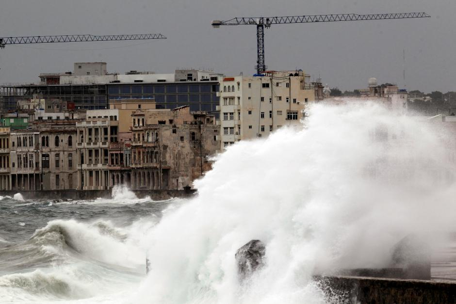 Waves crash against the seafront boulevard El Malecon ahead of the passi...