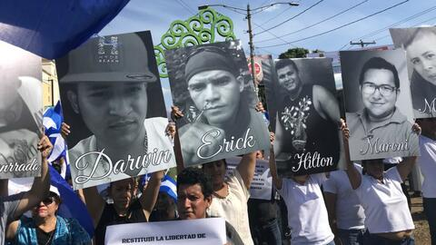 Protesters in Managua, Nicaragua hold images of fellow students killed i...