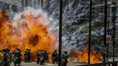 In photos: A fiery explosion on Sunday engulfed Venezuelan National Guard police on motor bikes.