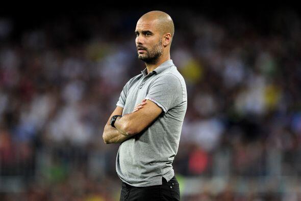 Josep Guardiola veía con atención a sus pupilos.