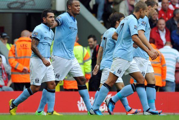 Marcador final con empate a dos goles entre el City y el Liverpool.