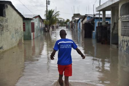 Man walking in Port-au-Prince slum, Cité Soleil, after Hurricane Matthew