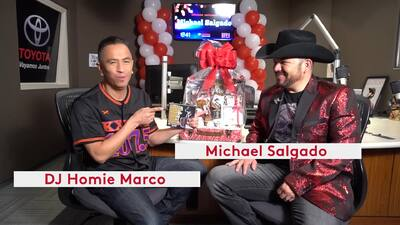 Homie Marco chats with Michael Salgado before his performance in the Uforia Lounge