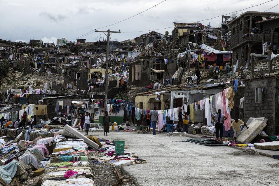 After the storm passed Haitians laid out wet clothing and bedding to dry...