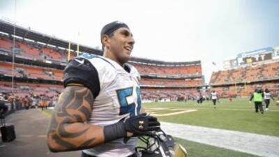 Jason Babin está fuera de los Jaguars (AP-NFL).