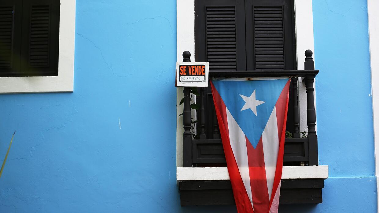 Opinión: El Lamento Borincano y las elecciones GettyImages-P-Rico-Debt.jpg